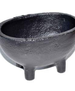 black cast iron cauldron with 4 legs shaped like an oval